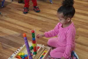 toddler using building blocks at Kidz Camp Montessori - Plano, TX