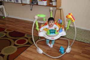 infant in jumper seat at kidz camp montessori school - plano, tx