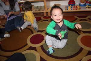 infant having fun in montessori school