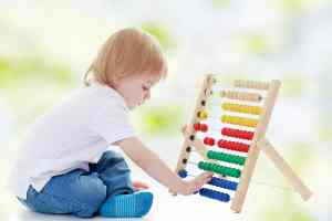 boy counting numbers on abacus in plano, tx